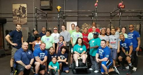 Image of KEEN athletes and volunteers with NYPD Powerlifters
